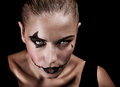 Terrifying witch closeup portrait of with creepy makeup and aggressive look isolated on black background halloween party concept Stock Photography
