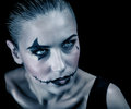 Terrifying witch closeup portrait of with creepy makeup and aggressive look isolated on black background halloween party concept Royalty Free Stock Photography