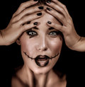 Terrifying witch portrait closeup of with spooky painted face and open mouth isolated on black background halloween holiday Royalty Free Stock Image