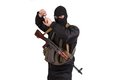 Terrorist in black uniform and mask with kalashnikov isolated Stock Image