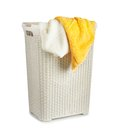 Terry towels in a laundry basket isolated Royalty Free Stock Photo