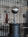 Tesla coil resonant transformer in faraday cage Royalty Free Stock Photos