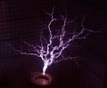 Tesla coil throwing man size sparks in a faraday cage Stock Photography