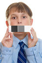 Test shot with photographic aid.   Child holding a qp card Royalty Free Stock Photo