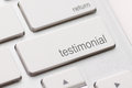 Testimonial on return key button white keyboard Stock Photo