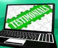 Testimonials Puzzle On Notebook Shows Online Credentials Royalty Free Stock Photo