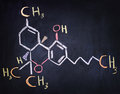 Tetrahydro-cannabinol & x28;THC& x29; formula written on a black board Royalty Free Stock Photo