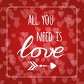 Text all you need is love on hearts bokeh Valentine day background. Romantic card. Lettering element