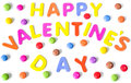 Text of colorful letters Happy Valentines day among multicolored round sweets. Isolated