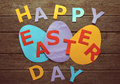 Text happy easter day on paper eggs colored a wooden table Stock Photos