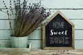 Text home sweet home in a house-shaped signboard Royalty Free Stock Photo