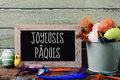 Text joyeuses paques, happy easter in french Royalty Free Stock Photo