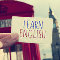 Text learn english in a signboard with the Big Ben in the backgr Royalty Free Stock Image