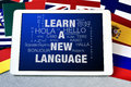 Text learn a new language in a tablet computer Royalty Free Stock Photo