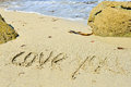 Text love you wriiten on sandy beach with ocean Stock Images