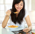 Text message and eating Stock Image
