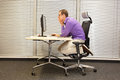 Text neck - man in slouching position working with computer Royalty Free Stock Photo