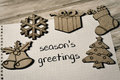 Text seasons greetings and some christmas ornaments