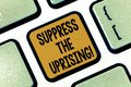Text sign showing Suppress The Uprising. Conceptual photo Invading and taking control by force To put an end Keyboard Royalty Free Stock Photo