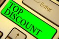 Text sign showing Top Discount. Conceptual photo Best Price Guaranteed Hot Items Crazy Sale Promotions Keyboard green key Intentio Royalty Free Stock Photo