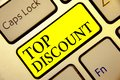 Text sign showing Top Discount. Conceptual photo Best Price Guaranteed Hot Items Crazy Sale Promotions Keyboard yellow key Intenti Royalty Free Stock Photo