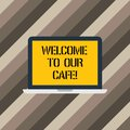 Text sign showing Welcome To Our Cafe. Conceptual photo Greeting receiving showing in restaurant good attention Laptop Royalty Free Stock Photo