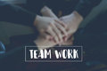 Text teamwork on background Hand coordination of the team Represents collaboration Royalty Free Stock Photo