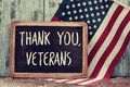Text thank you veterans in a chalkboard and the flag of the US Royalty Free Stock Photo