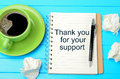 Text Thank you for your support on notebook Royalty Free Stock Photo