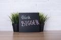Text think bigger on blackboard Royalty Free Stock Photo