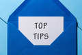 Text TOP TIPS on paper in blue envelope. Business concept Royalty Free Stock Photo