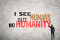 Text on wall i see humans but no humanity asian businessman write Royalty Free Stock Photo