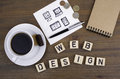 Text: Web design from wooden letters on a wooden table