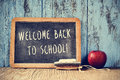 Text welcome back to school written on a chalkboard, cross proce Royalty Free Stock Photo