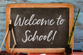 Text welcome to school written in a chalkboard Royalty Free Stock Photo