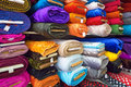 Textile and cloth rolls of tissue of various colours on the market Royalty Free Stock Photos