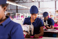 Textile factory machinist african working in production line Royalty Free Stock Images