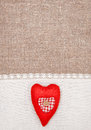 Textile heart and linen cloth on the burlap background Stock Photo