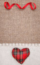 Textile heart and linen cloth on the burlap background Stock Image