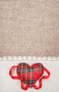 Textile heart and linen cloth on the burlap background Stock Photography
