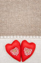 Textile hearts and linen cloth on the burlap background Royalty Free Stock Photo