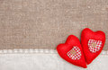 Textile hearts and linen cloth on the burlap background Royalty Free Stock Photography