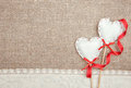 Textile hearts ribbon and linen cloth on the burlap background Stock Photography