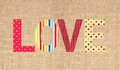 Textile letter love on sack canvas burlap background Stock Photos