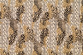 Textile with patterns of leopard and braids Royalty Free Stock Photography