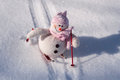 Textile snowman with snow slides down hill skiing Royalty Free Stock Photo