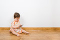 Texting baby on the floor on a phone Stock Photos