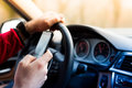 Texting and driving Royalty Free Stock Photo