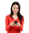 Texting on mobile phone young woman smiling and her isolated over white background mixed race southeast asian caucasian girl model Stock Image