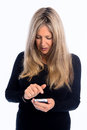 Texting for the old senior woman texts on cellular phone on white background Royalty Free Stock Photos